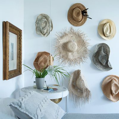 Hats on a white wall